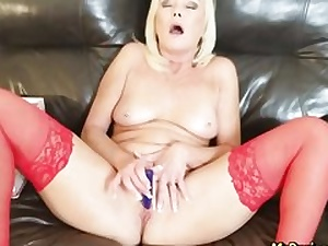 Sizzling ash-blonde dressed in crimson spandex stroking her slit crevice all alone