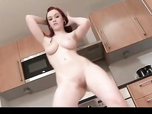 Molten red-haired demonstrating off her unbelievable naked bod on her kiytchen