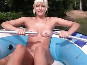 Platinum-blonde cockslut is swimming on the boat and blows a gigantic enormous donger